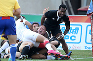 DJ Forbes reaches over for a try for New Zealand during the semi final of the medal competition of the Rugby Sevens between New Zealand and England held at Delhi University as part of the XIX Commonwealth Games in New Delhi, India on the 12 October 2010..Photo by:  Ron Gaunt/photosport.co.nz