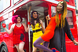 London, July 8th 2017. Thousands of LGBT+ revellers take part in the annual Pride in London parade under the banner #LoveHappensHere. PICTURED: Drag queens pose for the camera on a red London bus.