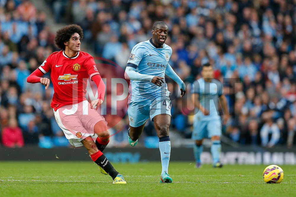 Marouane Fellaini of Manchester United shoots past Yaya Toure of Manchester City - Photo mandatory by-line: Rogan Thomson/JMP - 07966 386802 - 02/11/2014 - SPORT - FOOTBALL - Manchester, England - Etihad Stadium - Manchester City v Manchester United - Barclays Premier League.