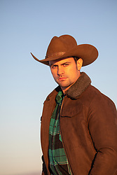 portrait of a cowboy at sunset