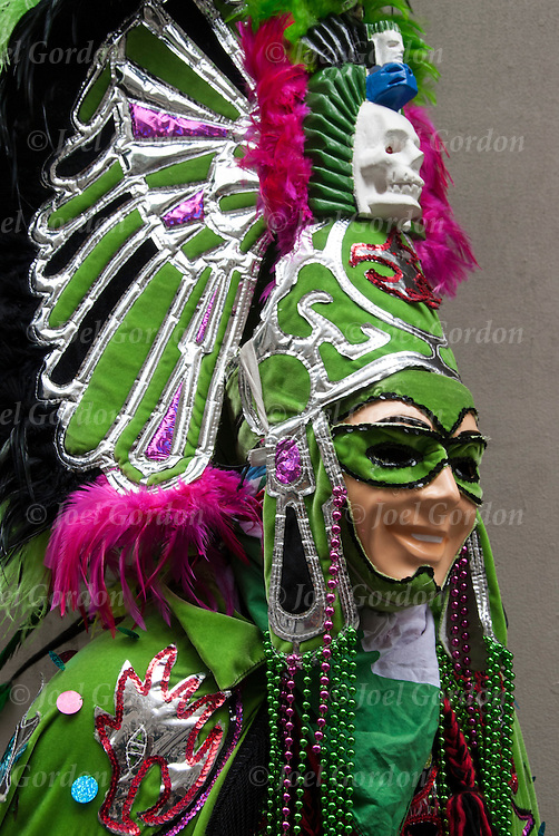 Mexican Day parade in NYC, head and shoulders portrait of Mexican American on showing  his ethnic pride,  dressed in traditional folk Carnival regalia and mask.
