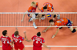 14-12-2010 VOLLEYBAL: CHAMPIONS LEAGUE ACH VOLLEY - OLYMPIACOS: LJUBLJANA SLOVENIA<br /> Kay van Dijk, Dejan Vincic and Matevz Kamnik of ACH during volleyball match between ACH Volley (SLO) and Olympiacos (GRE) in 4th Round of 2011 CEV Champions League<br /> ©2010-WWW.FOTOHOOGENDOORN.NL