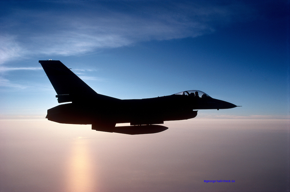 F-16 Falcon flying at sunset