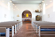 Pews at Jelling Kirke (Gudstjeneste) famous modern architecture church, birthplace of Christianity in Denmark