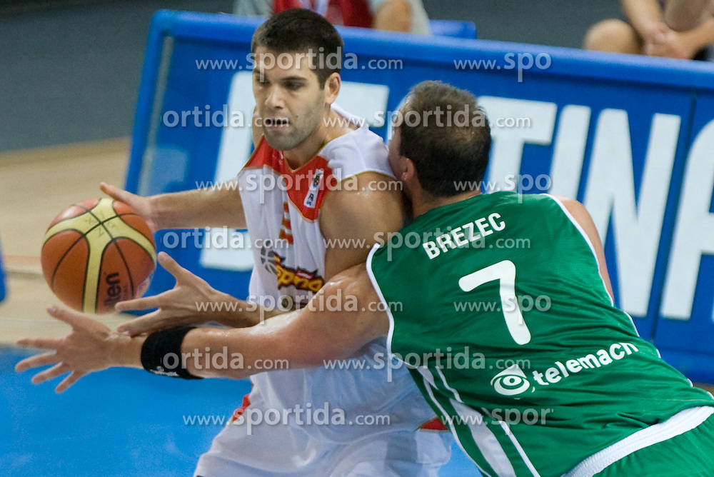 Felipe Reyes vs Primoz Brezec (7) of Slovenia during the basketball match at 1st Round of Eurobasket 2009 in Group C between Slovenia and Spain, on September 09, 2009 in Arena Torwar, Warsaw, Poland. Spain won 90:84 after overtime.(Photo by Vid Ponikvar / Sportida)