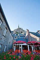 Looking up at the Abbey of Mont Saint Michel from a cafe in the streets below.