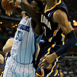 April 3, 2011; New Orleans, LA, USA; Indiana Pacers small forward Danny Granger (33) knocks the ball away from New Orleans Hornets center Emeka Okafor (50) during the first quarter at the New Orleans Arena.    Mandatory Credit: Derick E. Hingle