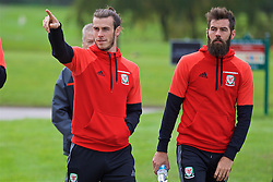CARDIFF, WALES - Friday, October 7, 2016: Wales' Gareth Bale and Joe Ledley during a team walk at the Vale Resort ahead of the 2018 FIFA World Cup Qualifying Group D match against Georgia. (Pic by David Rawcliffe/Propaganda)