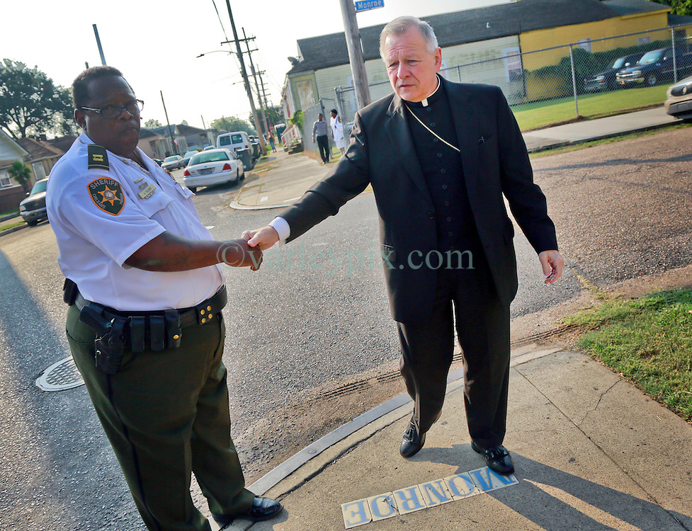 14 September 2013. Prayer Tower Church of God in Christ. New Orleans, Louisiana. <br /> Archbishop Gregory Aymond arrives at the funeral for 11 yr old Arabian 'Ray Ray' Gayles, fatally shot September 2nd. Arabian was cradling a 1 yr old cousin whilst sat on the couch at home when gunmen pulled up outside and sprayed the house with bullets. Arabian was hit in the head and died shortly afterwards. NOPD is questioning 2 men in connection with the murder.<br /> Photo; Charlie Varley