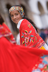 South America, Ecuador, Cuenca.  Girl dancer in folklore troupe during annual parade and festival to celebrate founding of Cuenca in 1557.  Cuenca is a UNESCO World Heritage Site.