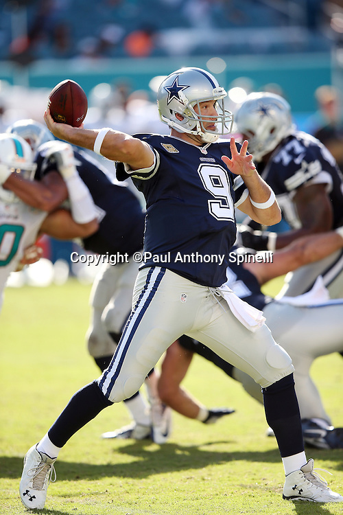 Dallas Cowboys quarterback Tony Romo (9) throws a third quarter pass for a first down during the 2015 week 11 regular season NFL football game against the Miami Dolphins on Sunday, Nov. 22, 2015 in Miami Gardens, Fla. The Cowboys won the game 24-14. (©Paul Anthony Spinelli)