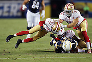 San Diego Chargers wide receiver Dom Williams (7) is tackled by San Francisco 49ers cornerback Will Redmond (23) after Williams catches a second quarter pass plus a personal foul penalty for a late hit by diving San Francisco 49ers cornerback Rashard Robinson (33) that gives the Chargers a first down and goal to go inside the ten yard line during the 2016 NFL preseason football game against the San Francisco 49ers on Thursday, Sept. 1, 2016 in San Diego. The 49ers won the game 31-21. (©Paul Anthony Spinelli)