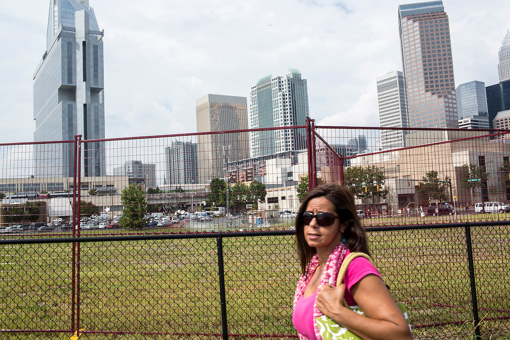 A woman walks outside the security perimeter for the Democratic National Convention on Tuesday, September 4, 2012 in Charlotte, NC.