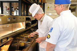 Willie Rennie, St Andrews, 24-4-2017<br /> <br /> Willie Rennie learns how to make fish and chips at Cromars in St Andrews, seen with Colin Cromar<br /> <br /> (c) David Wardle   Edinburgh Elite media