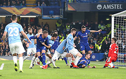 Chelsea's Cesar Azpilicueta (second right) shoots towards goal but is saved by Malmo goalkeeper Johan Dahlin (right)
