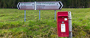 Postbox and Gaelic language signpost on a B road on the Ardnamurchan Peninsula in Highlands of Scotland, the most western point of the British mainland
