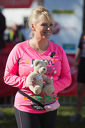 © Licensed to London News Pictures. 21/04/2013. London, England. Bucks Fizz singer and presenter Cheryl Baker. Celebrity Runners at a photocall before the start of the Virgin London Marathon 2013 race. Many wore black ribbons to pay their respect for those who died or were injured in the Boston Marathon. Photo credit: Bettina Strenske/LNP