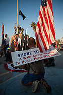 "Sinh Tho Nguyen, a veteran of the Army National Guard, completes his ""Shore to Shore"" journey on foot in San Diego's Ocean Beach on November 8.  Nguyen, 40, began the 2,500 mile walk on June 10 at Atlantic Beach in Jacksonville, Florida."