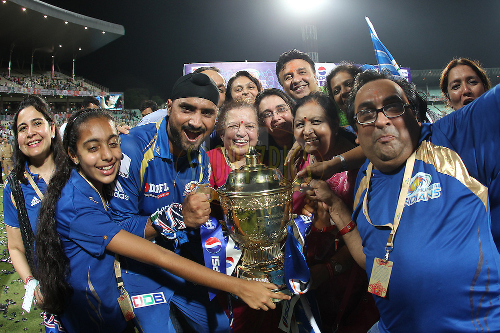 Harbhajan Singh celebrates with the trophy during the Final of the Pepsi Indian Premier League between The Chennai Superkings and the Mumbai Indians  held at the Eden Gardens Stadium in Kolkata on the 26th May 2013..Photo by Ron Gaunt-IPL-SPORTZPICS      ..Use of this image is subject to the terms and conditions as outlined by the BCCI. These terms can be found by following this link:..http://www.sportzpics.co.za/image/I0000SoRagM2cIEc