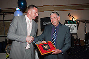 Robert Douglas returns Pat Liney's championship season blazer badge to the championship winning keeper. Pat had given the badge to recently deceased fan Wullie Reilly and the Reilly family thought he should have it back - Dark Blues Business Trust Ball and Player of the Year