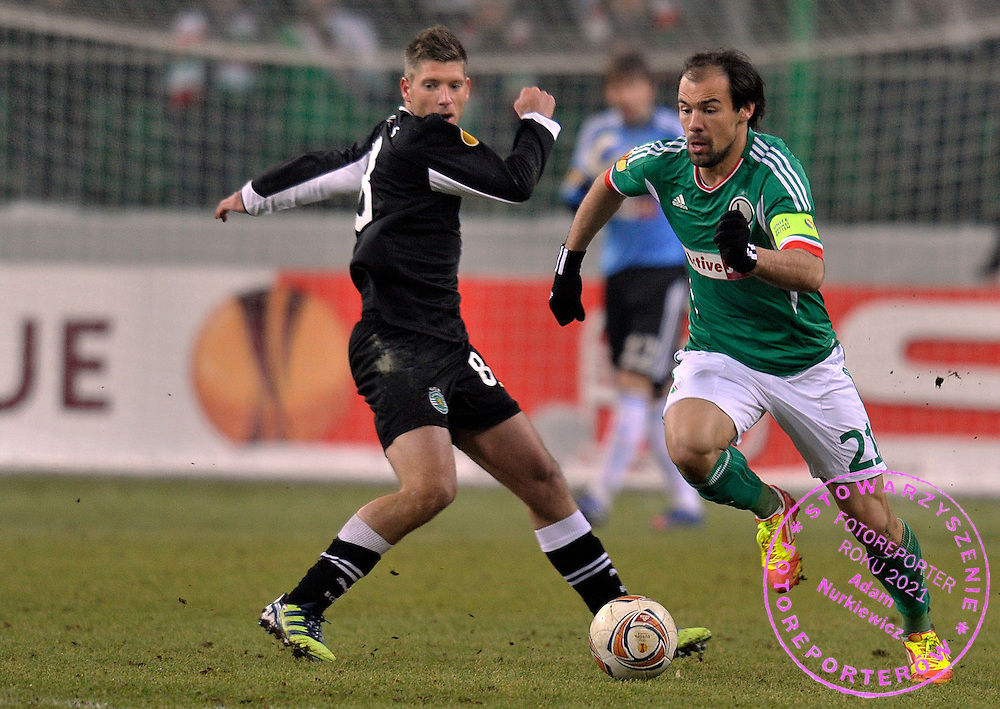 (R) Legia's Ivica Vrdoljak fights for the ball with (L) Sporting's Stijn Schaars during their UEFA Europa League football match between Legia Warsaw and Sporting Lizbona at Pepsi Arena Stadium in Warsaw on February 16, 2012...Poland, Warsaw, February 16, 2012..Picture also available in RAW (NEF) or TIFF format on special request...For editorial use only. Any commercial or promotional use requires permission...Photo by © Adam Nurkiewicz / Mediasport
