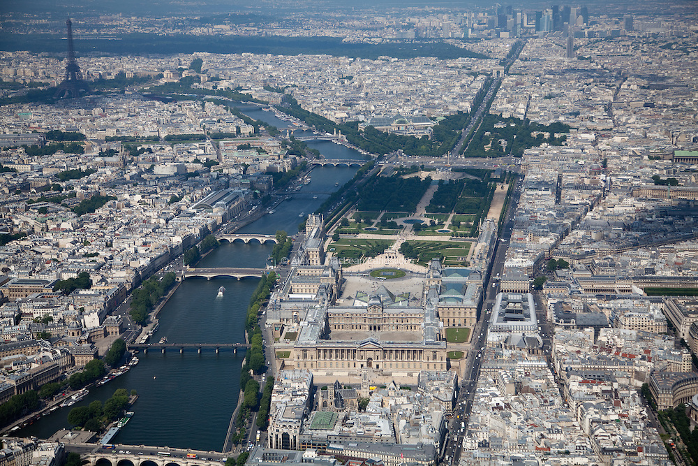 Along the right-side of the Seine river lies the Louvre Museum, the Tuileries Garden, and the well-known Champs-Elysees avenue leading to the Arc du Triomphe and the Grand Arche de La Defense.
