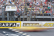 August 16, 2009: A car flashes by the flag tower at the CARFAX 400 race, Michigan International Speedway, Brooklyn, MI.
