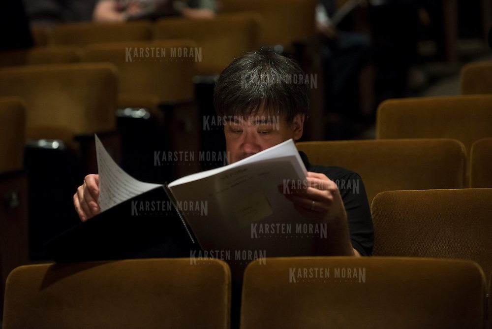 June 3, 2014 - New York, NY : As part of the New York Philharmonic Biennial, the orchestra solicited pieces from little-known composers and will choose three to play. Pictured here, New York Philharmonic Music Director Alan Gilbert listens as a piece is performed during rehearsal on Tuesday. CREDIT: Karsten Moran for The New York Times