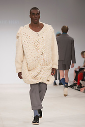 © Licensed to London News Pictures. 30/05/2015. London, UK. A model walks the runway during the Birmingham City University fashion show at Graduate Fashion Week 2015 wearing the collection of graduate student Katie Biggs. Graduate Fashion Week takes place from 30 May to 2 June 2015 at the Old Truman Brewery, Brick Lane. Photo credit : Bettina Strenske/LNP