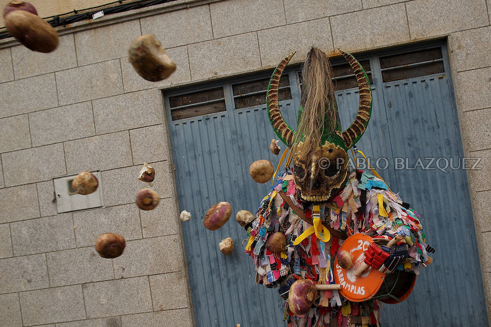 People throw turnips at the Jarramplas as he makes his way through the streets beating his drum during the Jarramplas Festival on January 20, 2015 in Piornal, Spain. The centuries old Jarramplas festival takes place annually every January 19-20 on Saint Sebastian Day. Even though the exact origins of the festival are not known, various theories exist including the mythological punishment of Caco by Hercules, a relation to ceremonies celebrated by the American Indians that were seen by the first conquerors, to a cattle thief ridiculed and expelled by his village neighbours. It is generally believed to symbolize the expulsion of everything bad. This year the people who represented Jarramplas were Angel Cerro Fernandez on 19 January and Carlos Calle Rodríguez 47 and Raúl Beites Sánchez 34 on 20 January.