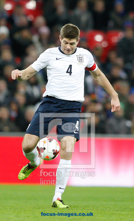 Picture by Andrew Tobin/Focus Images Ltd +44 7710 761829<br /> 19/11/2013   Steven Gerrard of England on the ball during the International Friendly match at Wembley Stadium, London.