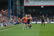 Luton Town midfielder Cameron McGeehan  and York City midfielder Russell Penn battle during the Sky Bet League 2 match between Luton Town and York City at Kenilworth Road, Luton, England on 10 October 2015. Photo by Simon Davies.