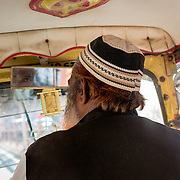 Interior of rickshaw speeding through traffic in Jaipur