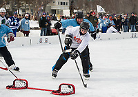 Frank Cirone of Team Bumbles sinks a shot to score in the final game of the 40+ division against the Frozen Hacks on Sunday during the New England Pond Hockey Classic.  (Karen Bobotas/for the Laconia Daily Sun)