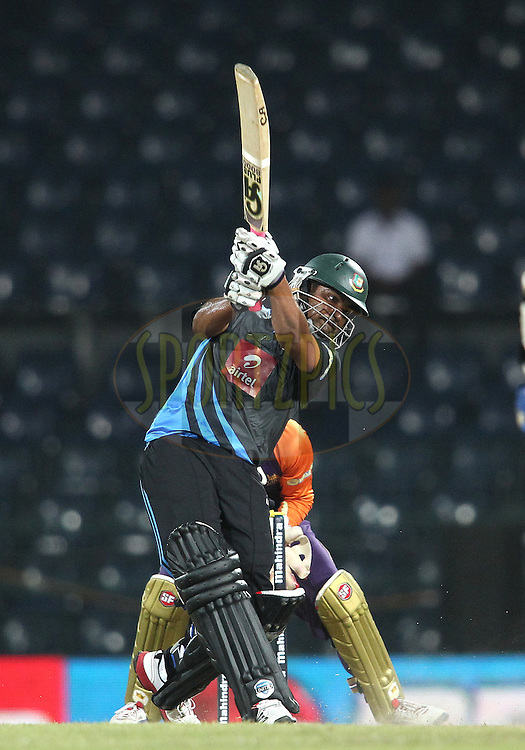 Tamim Iqbal of Wayamba United attacks a delivery during match 20 of the Sri Lankan Premier League between Ruhuna Royals and Wayamba United held at the Premadasa Stadium in Colombo, Sri Lanka on the 26th August 2012. .Photo by Shaun Roy/SPORTZPICS/SLPL