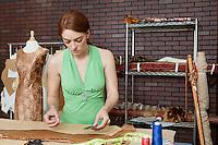 Female fashion designer working in design studio