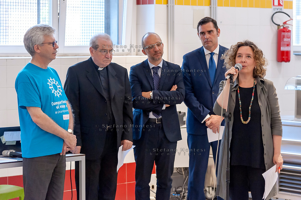 ROME, ITALY - JUNE 19: Michel Roy, Secretary General of Caritas Internationalis, Mgr Enrico Feroci, Director of Caritas Rome and Laura Baldassarre, councillor to the Person, School, and Community solidarity,  during the Day of Refuge, at the 'San Giovanni Paolo II' canteen in Via Marsala, the diocesan Caritas of Rome organized 'The Meal of the Meeting', with migrants and refugees to share the migratory experience. This is part of the awareness campaign 'Share the Journey' promoted by Caritas Internationalis and launched by Pope Francis on 27 September last on June 19, 2018 in Rome, Italy.