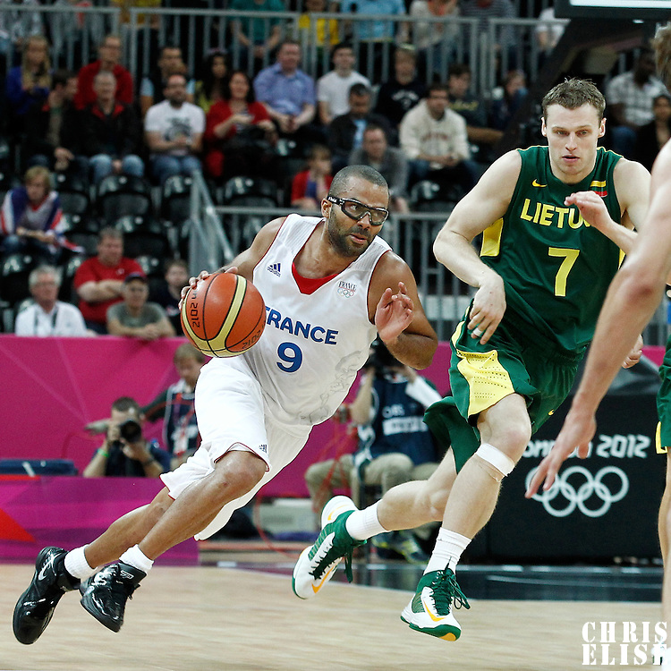 02 August 2012: France Tony Parker drives past Lithuania Martynas Pocius during 82-74 Team France victory over Team Lithuania, during the men's basketball preliminary, at the Basketball Arena, in London, Great Britain.