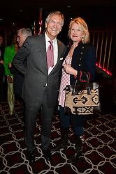 CHARLES DELEVINGNE and LOUISE FENNELL at a party to celebrate the publication of 'Passion for Life' by Joan Collins held at No41 The Westbury Hotel, Mayfair, London on21st October 2013.
