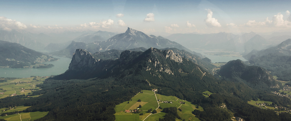 The view from Thalgau into the Salzkammergut, showing the full beauty of this landscape - the Mondsee on the left, then Drachenwand, Schober and Frauenkopf, with the famous Schafberg sitting on top of them, finalizing the view with the Wolfgangsee on the right.<br />