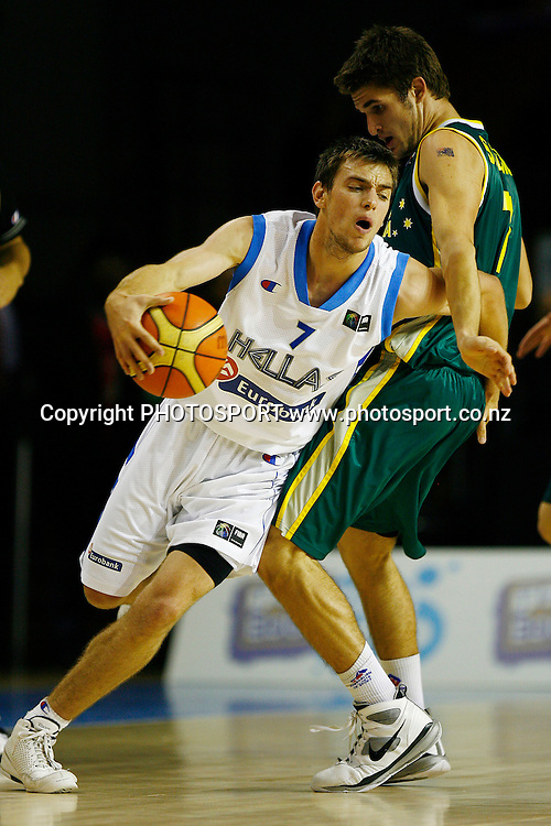 Greece's Evangelos Mantzaris dribbles around Australia's Christian Salecich. U19 Basketball World Championship, Semi-Finals, Greece v Australia, North Shore Events Centre, Auckland. 11 July 2009. Photo: Anthony Au-Yeung/PHOTOSPORT