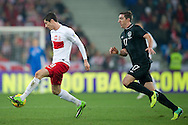 Poland's Robert Lewandowski (L) fights for the ball with Stephen Ward of Ireland (R) during international friendly soccer match between Poland and Ireland at Inea Stadium in Poznan on November 19, 2013.<br /> <br /> Poland, Poznan, November 19, 2013<br /> <br /> Picture also available in RAW (NEF) or TIFF format on special request.<br /> <br /> For editorial use only. Any commercial or promotional use requires permission.<br /> <br /> Mandatory credit:<br /> Photo by © Adam Nurkiewicz / Mediasport