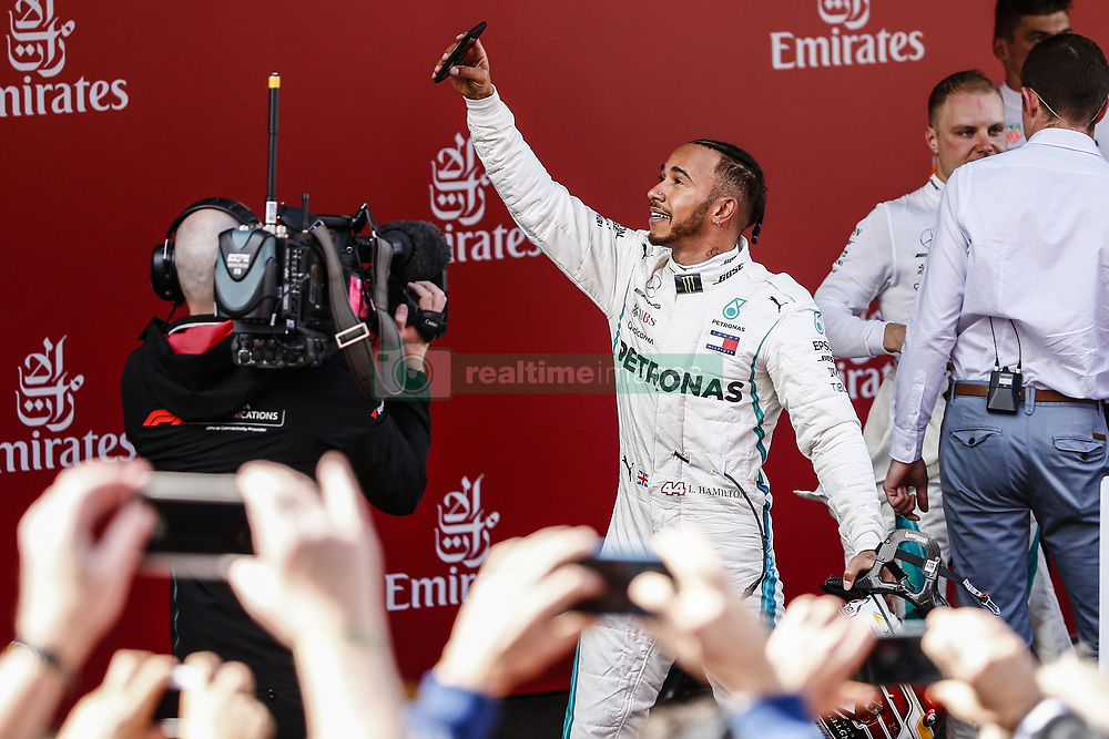 May 13, 2018 - Barcelona, Catalonia, Spain - 44 Lewis Hamilton from Great Britain Mercedes W09 Hybrid EQ Power+ team Mercedes GP celebrating his victory at the podium during the Spanish Formula One Grand Prix at Circuit de Catalunya on May 13, 2018 in Montmelo, Spain. (Credit Image: © Xavier Bonilla/NurPhoto via ZUMA Press)
