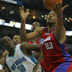 Jan 13, 2010; New Orleans, LA, USA; Los Angeles Clippers forward Marcus Camby (23) grabs a loose ball in front of New Orleans Hornets center Emeka Okafor (50) during the first quarter at the New Orleans Arena. Mandatory Credit: Derick E. Hingle-US PRESSWIRE