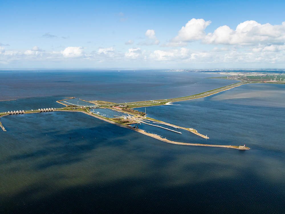 Nederland, Friesland, Gemeente Wonseradeel, 16-04-2012; Afsluitdijk ter hoogte van Kornwerderzand, gezien naar de kust van Friesland. Op het voormalig werkeiland liggen de Lorentzsluizen, een complex van spuisluizen en schutsluizen. De spuisluizen (uitwaterende sluizen) lozen van het IJsselmeer op de Waddenzee (links). De sluizen worden beschermd door kazematten (bunkers). .Enclosure Dam at the height of Kornwerderzand seen in the direction of the coast of Friesland. On the former work island the Lorentz locks, a complex of sluices and locks. The sluices sluice surplus water to the Wadden sea (l). The locks are protected by bunkers..luchtfoto (toeslag), aerial photo (additional fee required).foto/photo Siebe Swart