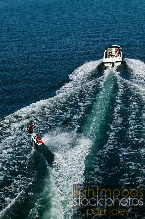 Aerial view of family waterskiing (wakeboarding) on Lake Macquarie, East Coast Australia