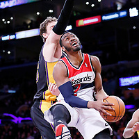 21 March 2014: Washington Wizards guard John Wall (2) goes for the reverse layup past Los Angeles Lakers center Pau Gasol (16) during the Washington Wizards 117-107 victory over the Los Angeles Lakers at the Staples Center, Los Angeles, California, USA.