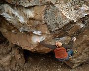 Jon Thompson climbing on the Ronin boulder, Markleeville CA