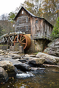 Babcock State Park is located along the New River Gorge in Fayette County, West Virginia, USA. Located near the park headquarters, the Glade Creek Grist Mill is among the most photographed tourist sites in the state of West Virginia. The Glade Creek Grist Mill is a replica of the original Cooper's Mill that was located nearby. The current grist mill, completed in 1976, was assembled from parts of three other West Virginia mills. The Glade Creek Grist Mill as a living, working monument to the more than 500 mills formerly running throughout the state.