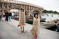 23/07/2018 Repro free:  Sean Clogherty Castlegar  and  Ruth Fergus from  Kingston 7 built there own carboard outfits at The People Build at Galway International Arts Festival saw not just one but two large-scale structures appear in a matter of hours built solely from cardboard. Under the guidance of French artist, Olivier Grossetete and his team, The People Build saw over 600 volunteers and members of the general public transform cardboard boxes into a church steeple and a bridge. This spectacular architectural event won the hearts of festival audiences and encouraged a sense of community where everyone could get involved. The structure built at Eyre Square was inspired by St. Nicholas&rsquo; Church in Galway and the bridge at Waterside was positioned at the location of Galway&rsquo;s River Corrib Viaduct, once part of the famous Galway to Clifden Railway.<br /> <br /> It is estimated that almost 4 tonnes of cardboard were used across the two builds. Following the constructions, children and grown-ups alike joined forces in a massive celebratory demolition, which saw the cardboard structures come tumbling down amidst shrieks of joy and delight.<br /> <br /> Walsh Waste &amp; Recycling have once again joined forces with Galway International Arts Festival to ensure there was no unnecessary waste following the event and were on hand to take away the crushed cardboard to be recycled. Photo:Andrew Downes, xposure